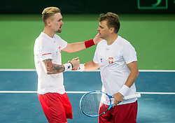 Mateusz Kowalczyk and Marcin Matkowski of Poland celebrate at doubles during the Day 2 of Davis Cup 2018 Europe/Africa zone Group II between Slovenia and Poland, on February 4, 2018 in Arena Lukna, Maribor, Slovenia. Photo by Vid Ponikvar / Sportida
