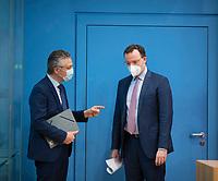 DEU, Deutschland, Germany, Berlin, 26.02.2021: Prof. Dr. Lothar H. Wieler, Präsident Robert Koch-Institut (RKI), und Bundesgesundheitsminister Jens Spahn (CDU) in der Bundespressekonferenz zur Corona-Lage im Lockdown.