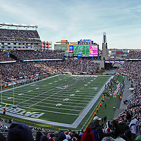 Gillette Stadium panorama photography images are available as museum quality photography prints, canvas prints, acrylic prints or metal prints. Prints may be framed and matted to the individual liking and decorating needs:<br /> <br /> http://juergen-roth.artistwebsites.com/featured/patriots-offense-juergen-roth.html<br /> <br /> New England Patriots at Gillette Stadium panorama photography displaying a magnificent view of this football arena with the Tom Brady offense at work. Gillette Stadium is a stadium located in Foxboro, MA, just 21 miles southwest of the city of Boston and 20 miles from the Rhode Island city of Providence. It provides the home field and administrative office for both the NFL New England Patriots football franchise and the MLS New England Revolution soccer team. In 2012, it also became the home stadium for the football program of the University of Massachusetts (UMass), making it the largest football stadium in the Mid-American Conference. The facility opened in 2002, replacing the old Foxboro Stadium. The seating capacity is 68,756, including 6,000 club seats and 87 luxury suites. The stadium is owned and operated by Kraft Sports Group, a subsidiary of The Kraft Group, the company through which businessman Robert Kraft owns the Patriots and Revolution.<br /> Good light and happy photo making!<br /> My best,<br /> <br /> Juergen<br /> www.RothGalleries.com<br /> https://www.facebook.com/naturefineart<br /> @NatureFineArt