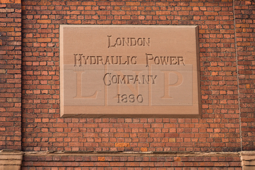 © Licensed to London News Pictures. 01/12/2013. London, UK. Image date: 23 November 2013. An original sign on the exterior wall of the Wapping Project (formerly the Wapping Hydraulic Power Station). The Wapping Project restaurant and art space will close at the end of 2013. Photo credit : Vickie Flores/LNP
