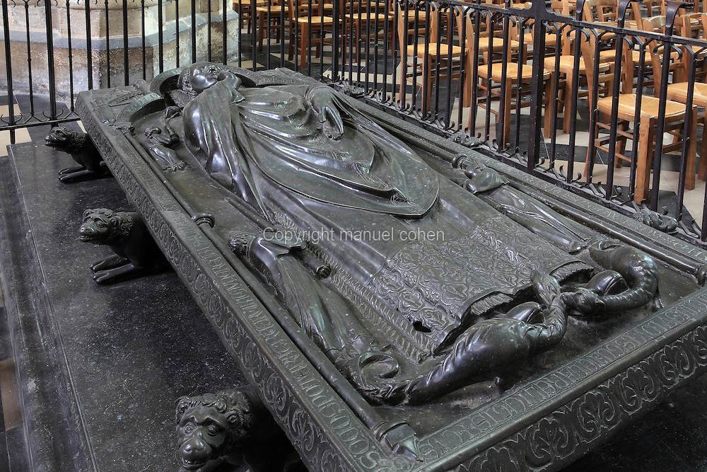 Tomb of Gisant d'Evrard de Fouilloy, bishop of Amiens 1211-22, who laid the first stone of the cathedral in 1220, bronze, 13th century, <br /> in the Basilique Cathedrale Notre-Dame d'Amiens or Cathedral Basilica of Our Lady of Amiens, built 1220-70 in Gothic style, Amiens, Picardy, France. The bishop's head rests on a cushion and his eyes are open, awake to eternal life. His right hand gestures in blessing and his left hand helds his crozier (now lost). 2 dragons are trampled underfoot and angels swing censers at the sides. Amiens Cathedral was listed as a UNESCO World Heritage Site in 1981. Picture by Manuel Cohen