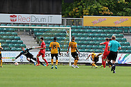 James Berrett (4) of York city shoots and scores his teams 1st goal. Skybet football league two match, Newport county v York city at Rodney Parade in Newport, South Wales on Saturday 5th Sept 2015.  pic by Andrew Orchard, Andrew Orchard sports photography.