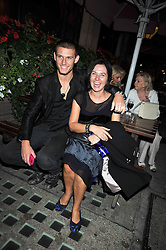 ALEX PETTYFER and GILLIAN McVEY at the opening of his pop up shop at 35 South Audley Street, London W1 on 19th September 2009.