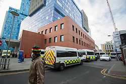 © Licensed to London News Pictures.30/12/2020, London, UK. A great number of ambulances wait outside The Royal London Hospital in Whitechapel, east London as the number of coronavirus cases surge due the new variant that considerably more transmissible than previous strains in London.  Photo credit: Marcin Nowak/LNP