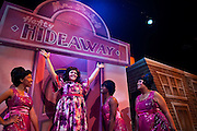 """Lindsey Hedberg, playing the role of Tracy Lindblad, raises her arms proudly during the Coeur d'Alene Summer Theatre's production of """"Hairspray."""" Hedberg is flanked by the three members of The Dynamites, left to right, Yudith Burton, Oyoyo Joi Bonner and Antonia Darlene.The show will premiere at North Idaho College's Boswell Hall Schuler Performing Arts Center at 7:30pm on August 7th."""