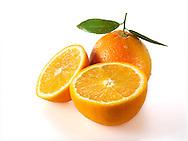 Fresh whole and cut oranges