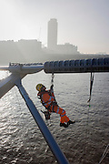 A cleaning crew with the contractor Conroy wash down surfaces on the Millennium Bridge for the first time in its 15 year history. A cleaning crew with the contractor Conway wash down surfaces on the Millennium Bridge for the first time in its 15 year history.