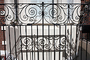 Ornate iron railings and their shadows outside exclusive property in Belgravia's Wilbraham Place SW1, London