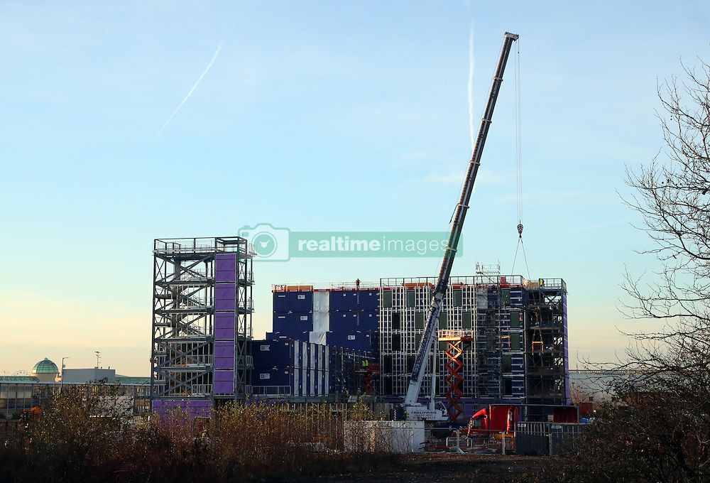 """A Holiday Inn Express Hotel made out of shipping containers has sprung up next to The Trafford Centre in Manchester. The 220 bedroom hotel is shipped as completed shipping containers from China. One builder said """"The rooms come complete with carpets, furniture, curtains already hung, numbers on the doors and the toilet roll is already in its holder."""