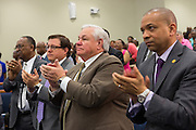 North Charleston Mayor Keith Summey applauds Rev. Al Sharpton during his address to a healing service at Charity Missionary Baptist Church April 12, 2015 in North Charleston, South Carolina. Sharpton spoke following the recent fatal shooting of unarmed motorist Walter Scott police and thanked the Mayor and Police Chief for doing the right thing in charging the officer with murder.