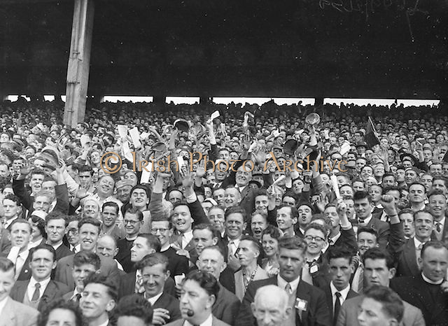 Kerry supporters cheering during the All Ireland Senior Gaelic Football Final Kerry v Down in Croke Park on the 22nd September 1960. Down 2-10 Kerry 0-8.