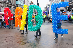 London, June 28th 2014. Despite the wet weather, the Pride London parade brings colour to London's wet streets