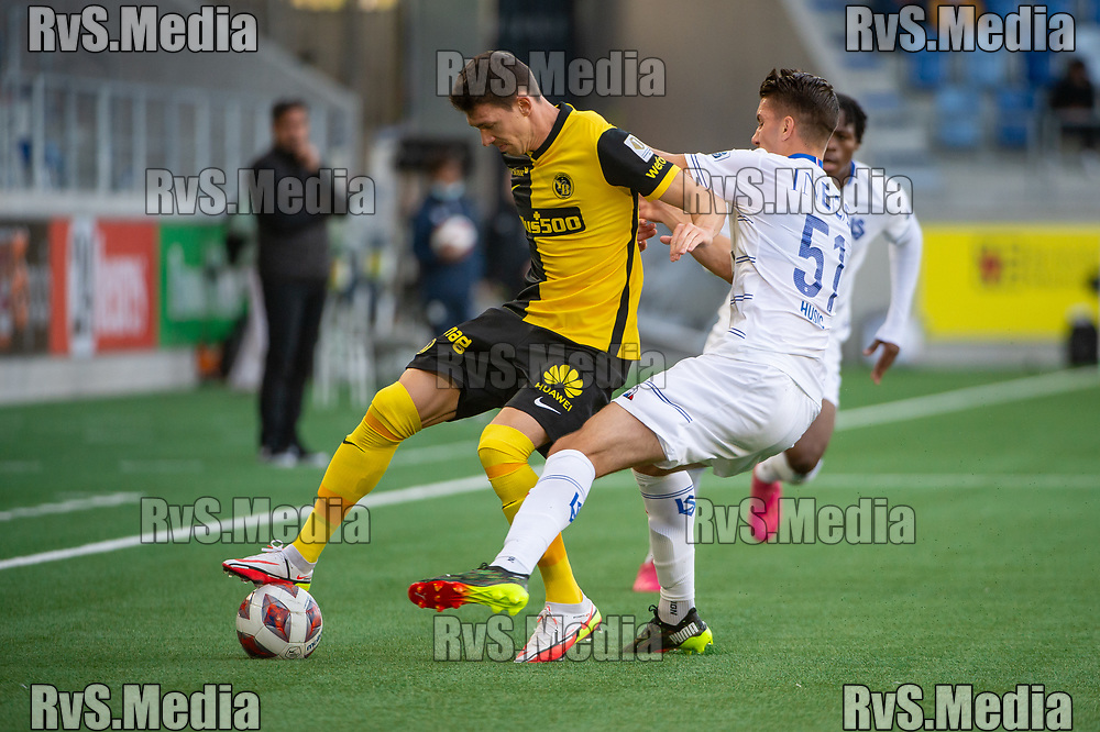 LAUSANNE, SWITZERLAND - SEPTEMBER 22: Christian Fassnacht #16 of BSC Young Boys battles for the ball with Anel Husic #51 of FC Lausanne-Sport during the Swiss Super League match between FC Lausanne-Sport and BSC Young Boys at Stade de la Tuiliere on September 22, 2021 in Lausanne, Switzerland. (Photo by Monika Majer/RvS.Media)