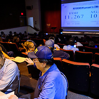 072115       Cable Hoover<br /> <br /> Tim Sanchez, left, of Automated Election Services and Kimmeth Yazzie of the Navajo Election Administration enter voting results on a projection screen for a crowd at the Navajo Nation Museum in Window Rock Tuesday.
