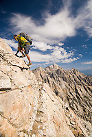 A young man climbs the east ridge of Buck Mountain in Grand Teton National Park, Jackson Hole, Wyoming.