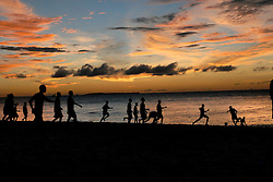 Children play on the beach of Zanzibar in Tanzania.