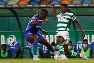 Nuno Mendes and Cafu divide the ball during the Liga NOS match between Sporting Lisbon and Belenenses SAD at Estadio Jose Alvalade, Lisbon, Portugal on 21 April 2021.