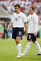 Photo: Chris Ratcliffe.<br /> <br /> England v Ecuador. 2nd Round, FIFA World Cup 2006. 25/06/2006.<br /> <br /> Joe Cole and Wayne Rooney of England.