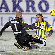 Fenerbahce's Mehmet TOPUZ (R) during their Turkish Superleague soccer match Genclerbirligi between Fenerbahce at the 19 Mayis stadium in Ankara Turkey on Monday 07 March 2011. Photo by TURKPIX