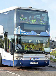 Pictured: Extra police arrive on a double decker bus.<br /> <br /> Protesters gathered amid tight security at the Trump Turnberry resort, where President Trump and his wife Melania are staying on their trip to Scotland.<br /> <br /> © Dave Johnston / EEm