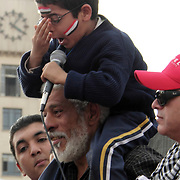 Catching his glasses as he bellows with all his might, this small revolutionary fluently delivers words of hope and unity to the assembled masses in Cairo's Tahrir Square.