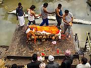 04 MARCH 2017 - KATHMANDU, NEPAL:  A Hindu cremation on the ghats at Pashupatinath UNESCO World Heritage Site in Kathmandu.    PHOTO BY JACK KURTZ