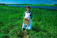"""Young girl portraying """"Anne of Green Gables"""", Lake of Shining Waters, near Park Corner, Prince Edward Island, Canada"""
