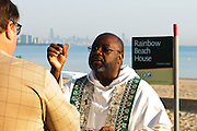 Chicago Catholics gather for a sunrise mass at Rainbow Beach on the city's south side to pray for peace and non-violence during the upcoming school year. The event hosted by The Black Catholic Deacons in the Archdiocese of Chicago is one of six simultaneous masses along Chicago's lakefront. August 25, 2012 l Brian J. Morowczynski~ViaPhotos...For use in a single edition of Catholic New World Publications, Archdiocese of Chicago. Further use and/or distribution may be negotiated separately. Contact ViaPhotos at 708-602-0449 or email brian@viaphotos.com.