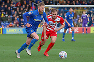 AFC Wimbledon midfielder Scott Wagstaff (7) dribbling during the EFL Sky Bet League 1 match between AFC Wimbledon and Doncaster Rovers at the Cherry Red Records Stadium, Kingston, England on 9 March 2019.