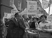Irish Nurses Organisation Protest..28.05.1986..05.28.1986..28th May 1986..In protest against proposed health cuts the Irish Nurses Organisation organised a protest march to Dail Eireann. Nurses from all over Ireland were represented at the march...Dail Deputy Sean Doherty TD,Fianna Fail comes to the barrier to speak with the protesting nurses.