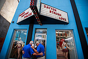 """08072019 - Dayton, Ohio, USA: A group of men stop to pray under signs reading, """"Thanks Dayton Police,"""" and Dayton Strong Love,"""" on 5th Street at the site of Sunday morning's mass shooting that left 9 dead, and 27 wounded, Wednesday, August 7, 2019 in Dayton, Ohio. Trump visited a nearby hospital but did not visit the site of the shooting before flying to El Paso, Texas, which was also the site of a mass shooting."""