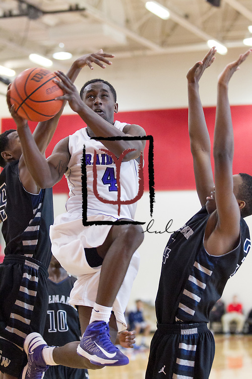 Cedar Ridge's DD Harris attempts to put up a shot against Shoemaker during the Leander ISD Tournament Friday.  The Raiders beat the Grey Wolves 58-37 at Vista Ridge Gym.