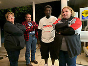 Belinda and Gordon Beers and Jimmie and Alyssa Davis have waited for close to an hour to get close to the entrance to their polling place.