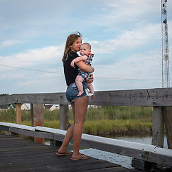 August 4, 2017 - Tangier Island, VA - Layla Park and her nephew near the cell phone and water tower of Tangier Island . Due to the island's diminishing surface area it is uncertain whether Tangier Island youth will grow up on the island as generations of their ancestors have done on the small, tight-knit island community of watermen and their families.<br /> <br /> Photo by Susana Raab/Institute