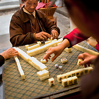 Passing the afternoon with a game of majong in Heshun town, Yunnan province, China.