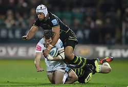Exeter Chiefs' Ian Whitten is tackled by Northampton Saints' Luther Burrell during the Gallagher Premiership match at Franklin's Gardens, Northampton.