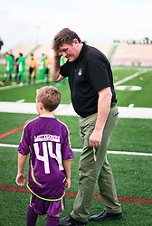 13 June 2015. New Orleans, Louisiana.<br /> National Premier Soccer League. NPSL. <br /> Manager Kenny Farrell talks with Ben before kick off. The New Orleans Jesters play against Texas' Premier Soccer League's (TPSL) runner-up, Houston Hurricanes at home in the Pan American Stadium. Jesters take a 3-1 victory at the final whistle. <br /> Photo; Charlie Varley/varleypix.com