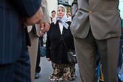 Moscow, Russia, 02/08/2006..A woman prays in the street outside a church as Russian Orthodox believers celebrate Saint Ilyin's Day in and around Red Square..