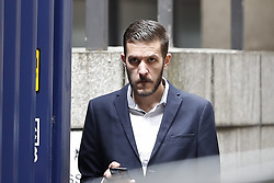© Licensed to London News Pictures. 13/07/2017. London, UK. Chris Gard smokes outside court after leaving the court during proceedings. The parents of terminally ill Charlie Gard have returned to the High Court in light of new evidence relating to potential treatment for their son's condition. An earlier lengthy legal battle ruled that Charlie could not be taken to the US for experimental treatment. London, UK. Photo credit: Peter Macdiarmid/LNP