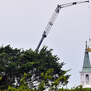 Robbie Schulz, worker with South Carolina Lightning Protection Inc., of Mount Pleasant, installs a lightning rod to the top of the steeple of The Parish Church of St. Helena, off of Newcastle Street, in Beaufort, on April 20, 2015. To watch a video, go to:http://bit.ly/1gf1c6W
