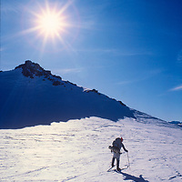 Ski mountaineers cross an unnamed pass south of Mount Humphreys in the Sierra Nevada, CA.