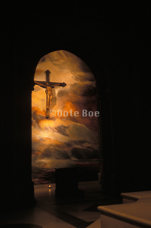 Crucifix from the dark interior of a church