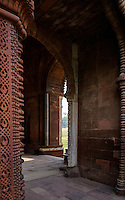 NEW DELHI, INDIA - CIRCA OCTOBER 2016: Inscriptions and entrance arch to the Alai Darwaza Mosque of the Qutb Minar Complex. The complex features is an array of monuments and buildings at Mehrauli in Delhi, India. An Unesco World Heritage Site and popular touriest attraction in Delhi.