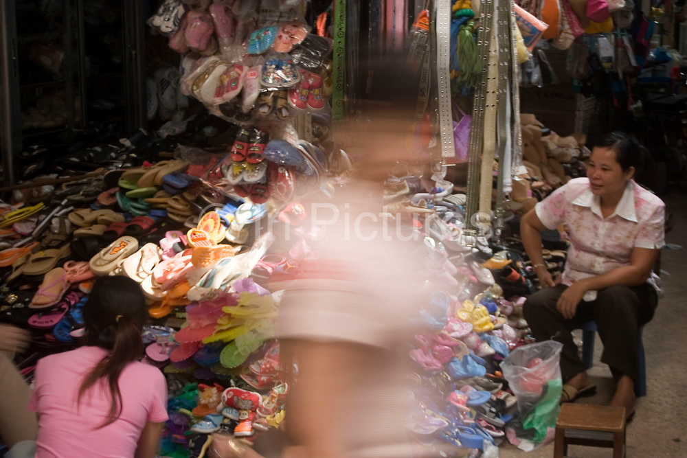 Plastic shoes for sale. Psar Leu market at the heart of this transport stop just outside Siem Reap to the east. This huge market entirely populated by locals is the central place to buy almost any goods, from a piece of pork to a gold bracelet. This is a covered market whose food sections bustle with energy and customers.
