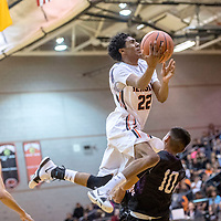 Gallup Bengal Zakarri Fields (22), left, draws a foul from  Miyamura Patriot Gabriel Lee jr. (10) in the district 1-5A tournament game at Gallup High School Wednesday. The Bengals outlasted the Patriots with a 41-38 win.