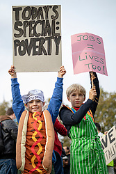 © Licensed to London News Pictures. 19/10/2020. London, UK. Xavi (8) and Ramsey (9) wave placards and bang pans in Parliament Square as workers in the hospitality sector protest against the impact COVID-19 restrictions are having on the hospitality industry. Photo credit: Rob Pinney/LNP