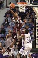 Texas A&M forward Joseph Jones (C) pulls down a defensive rebound over Kansas State's Cartier Martin (20) and Mario Taybron (22) during the first half of K-State's 58-54 win over the Aggies at Bramlage Coliseum in Manhattan, Kansas, January 18, 2006.