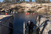 A diver emerges from the Blue Hole in Santa Rosa New Mexico. - Steven St. John for New Mexico Magazine
