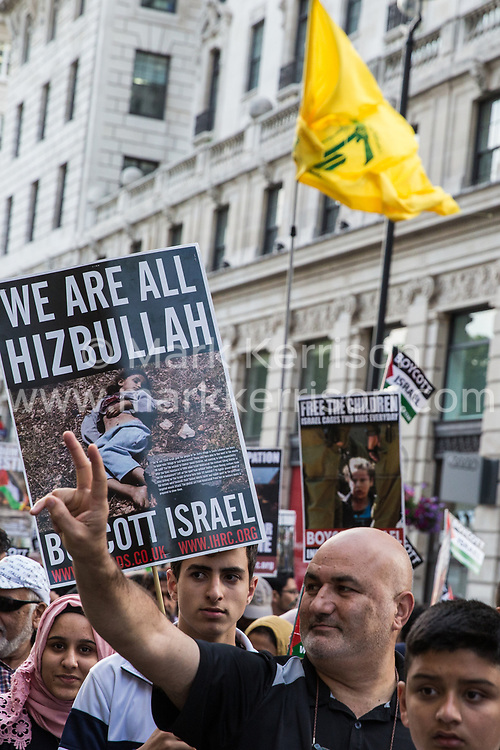 London, UK. 10th June, 2018. A Hezbollah flag flies above hundreds of people taking part in the pro-Palestinian Al Quds Day march through central London organised by the Islamic Human Rights Commission. An international event, it began in Iran in 1979. Quds is the Arabic name for Jerusalem.