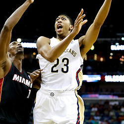 Oct 23, 2013; New Orleans, LA, USA; New Orleans Pelicans power forward Anthony Davis (23) shoots over Miami Heat power forward Chris Bosh (1) during the first quarter of a preseason game at New Orleans Arena. Mandatory Credit: Derick E. Hingle-USA TODAY Sports